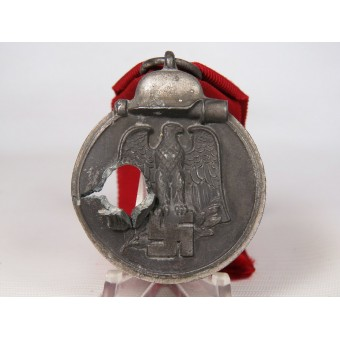 Medal for the 1941-42 campaign on the Eastern Front with battle damage. Espenlaub militaria