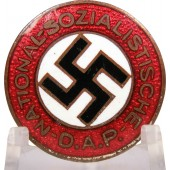 One of the early issues of the NSDAP party member badge. GES.GESCH