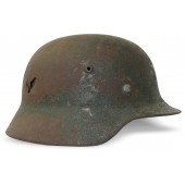 German m35 Wehrmacht Heer steel helmet. Battle damaged!