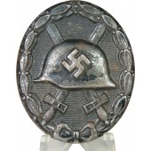 Black wound badge in steel