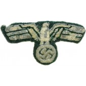 Wehrmacht Heer. Heavily worn condition visor or field hat bullion eagle.