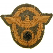 WW2 German Police arm eagle for Gendarmerie on a piece of DAK wool