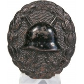 A black 1918 Wound badge. Die stamped iron in black lacquer