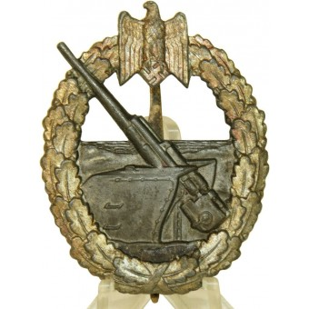 Kriegsmarine Kriegsabzeichen fur die Marineartillerie / Coastal Artillery badge In gilded zinc, with maker Ausf C.E. Juncker Berlin