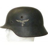 German M-35 Luftwaffe SE 66 steel helmet with battle damage