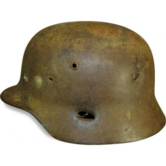 ET 64 marked M 35 war time reissued camouflaged steel helmet with fragmentation damage. Espenlaub militaria
