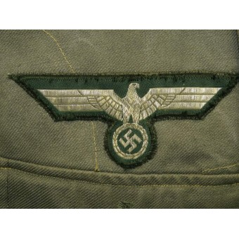 Summer Wehrmacht tunic M 43, official issue for officers in rank Lieutenant of artillery. Espenlaub militaria