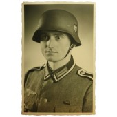 Portrait photo of Wehrmacht Unteroffizier in M35 helmet.