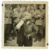 German coastal Kriegsmarine soldiers coerced  loclchildren to drink the alcohol and smoke the cigarette