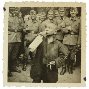 German coastal Kriegsmarine soldiers coerced  loclchildren to drink the alcohol and smoke the cigarette. Espenlaub militaria