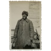 Soviet POW wearing overcoat
