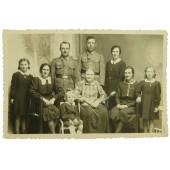Two German soldiers, veterans of the Eastern Front with their family
