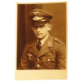Photo portrait: Luftwaffe Flak-artillery soldier wearing Tuchrock and  LW visor cap