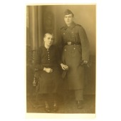 Studio photo, Wehrmacht soldier in overcoat with mother