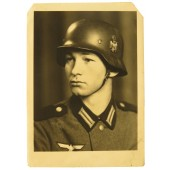 Studio portrait of the infanterist of the Wehrmacht in a helmet and  M36 tunic
