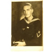 Photo portrait of the enlisted sailor of Kriegsmarine, with a patch of ordinance engineer