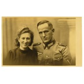 Studio photo of a German Gefreiter in m36 Feldbluse with his wife