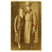 German soldier from Bavaria in overcoat with wife