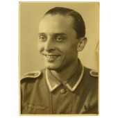 Studio portrait of German Unteroffizier in M 40 tunic with Czech anschluss medal