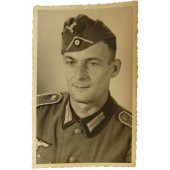 Photo of Wehrmacht infantryman in the side cap with a white soutache