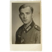 Portrait photo of a Wehrmacht pioneer in a tunic with a dark green collar