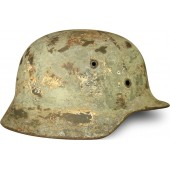 M 40 Waffen SS steelhelmet. Battle damage