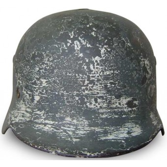 M35 Battle damaged double decal camo steel helmet. Espenlaub militaria