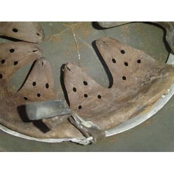 M35 Battle damaged double decal camo steel helmet. Espenlaub militaria