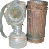 Early 1st model gasmask with canister