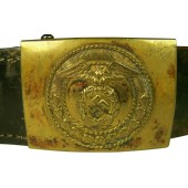 SA buckle, with a black belt, may be worn by the NSKK member.