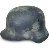 German M40 Winter camouflaged steel helmet