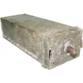 Deactivated 1 kilo explosive charge metal container.