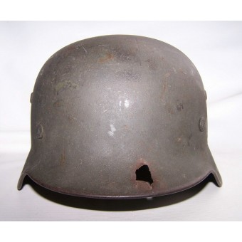 M 35 , Q 64 helmet, post 1940 year reissue, battle damaged !. Espenlaub militaria