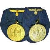 2 Medals for Service in Wehrmacht: for 4 years and for 12 years.